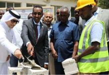 Somalia's Minister of Foreign Affairs Ahmed Eissa Awad (Second left) and Qatar ambassador Hassan bin Hamza Hashim (L) places the cornerstone of the project.