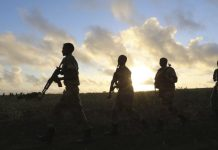FILE - Somali army soldiers are seen near Barawe, Somalia, Oct. 4, 2014. Somalian soldiers might soon join peacekeeping forces in South Sudan. Share Print