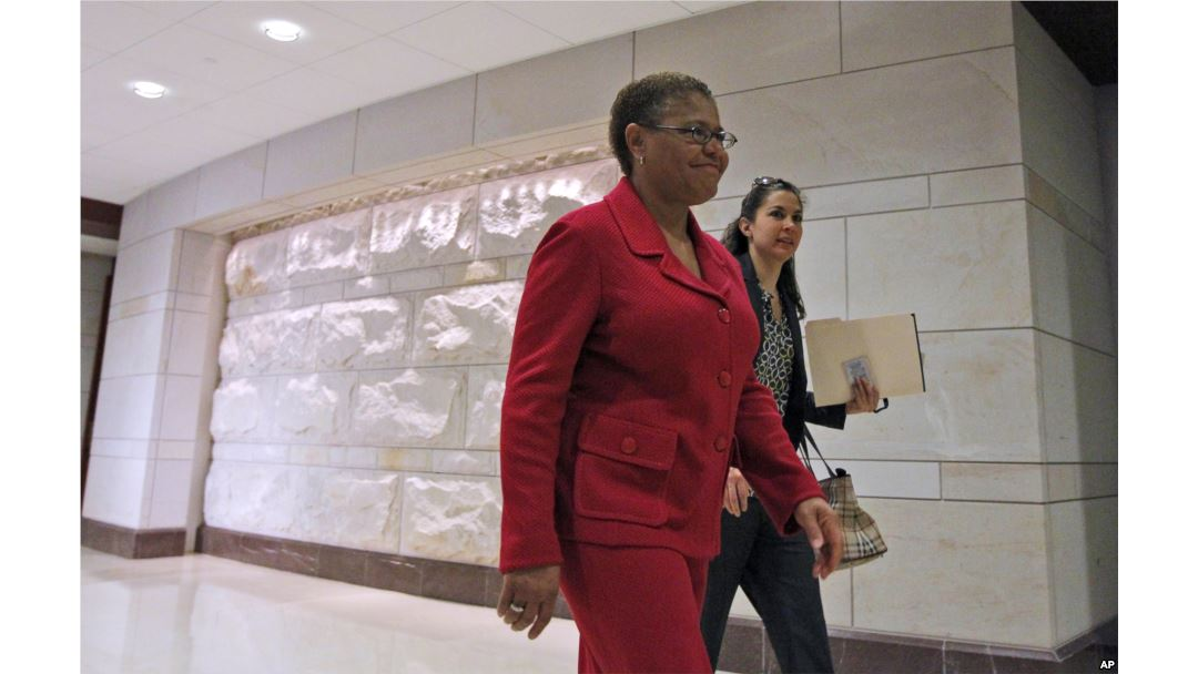 FILE - Rep. Karen Bass, D-Calif., walks through the Capitol Visitors Center on Capitol Hill in Washington.