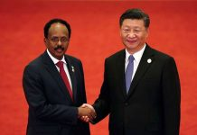 Somalia's President Mohamed Abdullahi Mohamed (left) shakes hands with China's President Xi Jinping during the Forum on China-Africa Cooperation at the Great Hall of the People in Beijing on September 3, 2018. Somalia is trying to restore good relations with the global community. PHOTO | ANDY WONG | AFP