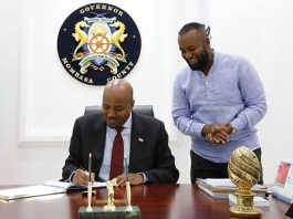 Somaliland's envoy to Kenya Bashe Awil Omar (seated) and Mombasa Governor Hassan Joho agree to spur economic development. PHOTO | COURTESY