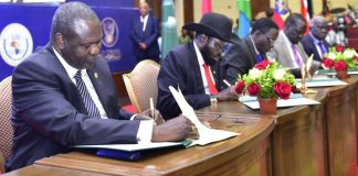 outh Sudan rebel leader Riek Machar and President Salva Kiir sign a power-sharing deal, August 5, 2018. Image: KagutaMuseveni/Twitter