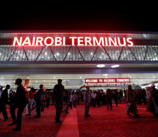 "Red neon announces the ""Nairobi Terminus"" at the Chinese-financed Standard Gauge Railway station in Kenya's capital. Thomas Mukoya/Reuters"