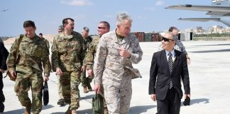 U.S Marine Gen. Thomas D Waldhauser, Commanding general, U.S. Afric Command, speaks with U.S Ambassador to Somalia Donald Yamamoto at Aden Adde International Airport in Mogadisu, Somalia (U.S Navy Photo by Mass Communication Specialist 1st Class nICK sCOTT)