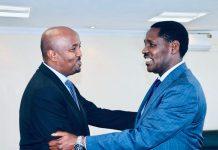 Somaliland envoy to Kenya Mr Bashe Awil Omar and Minister for Trade Peter Munya at the Trade ministry offices in Nairobi on November 15, 2018. PHOTO | COURTESY