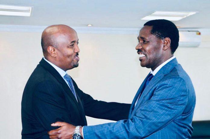 Somaliland envoy to Kenya Mr Bashe Awil Omar and Minister for Trade Peter Munya at the Trade ministry offices in Nairobi on November 15, 2018. PHOTO   COURTESY