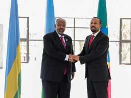 Ethiopian Prime Minister Abiy Ahmed shakes hands Djibouti President Ismaïl Omar Guelleh