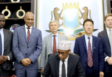 Somali Fisheries Minister Signing the agreement in the presence of Deputy PM