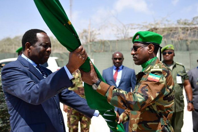 Ambassador Francisco Madeira, the Special Representative of the Chairperson of the African Union Commission (SRCC) for Somalia hands an African Union flag to Lt. Gen. Tigabu Yilma Wondimhunegn, the new AMISOM Force Commander. This was during an AMISOM Force command handover/takeover ceremony in Mogadishu, Somalia, on 31 January 2018. AMISOM Photo / Ilyas Ahmed