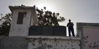 UN Photo/Tobin Jones Guard at watchtower of UN Compound in Mogadishu, Somalia (file photo, June 2013).