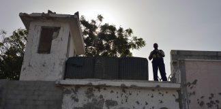 UN Photo/Tobin Jones Guard at watchtower of UN Compound in Mogadishu, Somalia (file photo, June 2013).