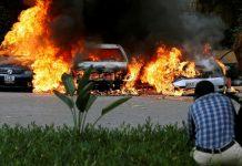 (Thomas Mukoya/Reuters) Cars are seen on fire at the scene of explosions and gunshots in Nairobi, Kenya, Jan. 15, 2019.