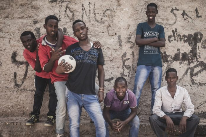 A group of young men in Somaliland's capital, Hargeisa, take a break from an informal football match. Youth unemployment in Somaliland is among the highest in the world at between 60 and 70 per cent. Photo: Adrian Leversby/IRIN