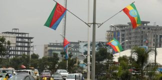 FILE PHOTO: Ethiopia's and Eritrea's flags are displayed on the street ahead of Eritrea's President Isaias Afwerki's visit to Addis Ababa, Ethiopia July 13, 2018. REUTERS/Tiksa Negeri/File Photo Read more at https://www.channelnewsasia.com/news/world/eritrea-closes-border-crossing-to-ethiopians--official-and-residents-say-11070902