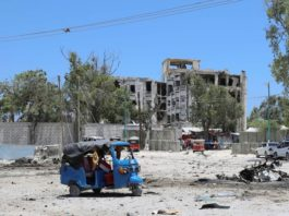 A rickshaw is seen near the scene of a suicide explosion after al-Shabaab militia stormed a government building in Mogadishu, Somalia March 23, 2019. REUTERS/Feisal Omar