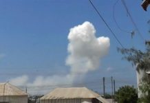 Al-Shabab said one of its fighters rammed the ministry building with a suicide car bomb [Reuters]