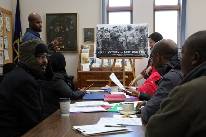 Somali residents study at the Barron Public Library for upcoming U.S. Citizenship tests. Test-takers are presented with 10 questions picked from a list of 100 during naturalization interviews. Rich Kremer/WPR