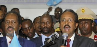 New Somali President Mohamed Abdullahi Farmajo, right, is joined by incumbent President Hassan Sheikh Mohamud, left, as he speaks to reporters after winning the election in Mogadishu, Somalia, February 8, 2017. (AP Photo/Farah Abdi Warsameh)