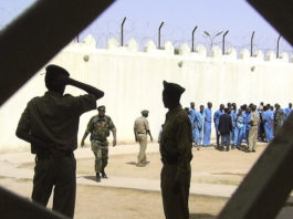 Prison guards are seen at Somaliland's Hargeisa prison on March 29, 2011. Television reporter Abdirahman Keyse Mohamed was recently arrested by police in Somaliland and is being held without charge in a prison in Las Anod. (AP/Katharine Houreld)