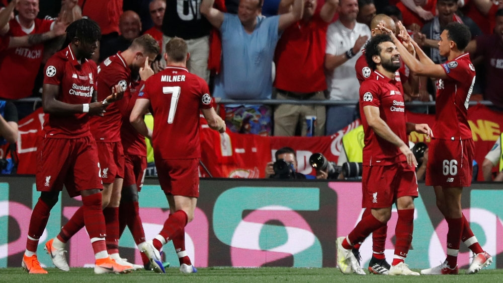 Liverpool's Divock Origi celebrates scoring their second goal with James Milner, Mohamed Salah and team mates [Susana Vera/Reuters]