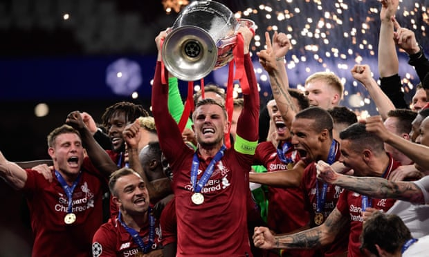 Liverpool's captain, Jordan Henderson, raises the Champions League trophy after their victory over Spurs in Madrid. Photograph: Javier Soriano/AFP/Getty Images
