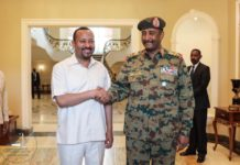Ethiopian PM Abiy Ahmed Handshake with Lieutenant General Abdel-Fattah Burhan, head of the Sudanese Transitional Military Council