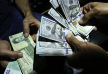 File photo showing a man exchanging Iranian rials for US dollars in Tehran, Iran (photo credit BBC)