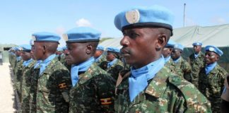 Soldiers stand guard during the formal inauguration ceremony of the United Nations Guard Unit (UNGU), a defensive military enity mandated to protect UN staff and installations in Mogadishua, capital of Somalia, May 18, 2014. The UNGU is made up of 410 troops provided by the Uganda People's Defence Forces. The Guard Unit, led by a Ugandan Commander, falls under the responsibliity of the UN designated official in Somalia. (Xinhua/Faisal Isse)