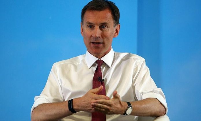 Britain's Foreign Secretary Jeremy Hunt takes part in a Conservative Party leadership hustings event in Exeter, southwest England on June 28, 2019. - Britain's leadership contest is taking the two contenders on a month-long nationwide tour where they will each attempt to reach out to grassroots Conservatives in their bid to become prime minister. (Photo by GEOFF CADDICK / AFP)