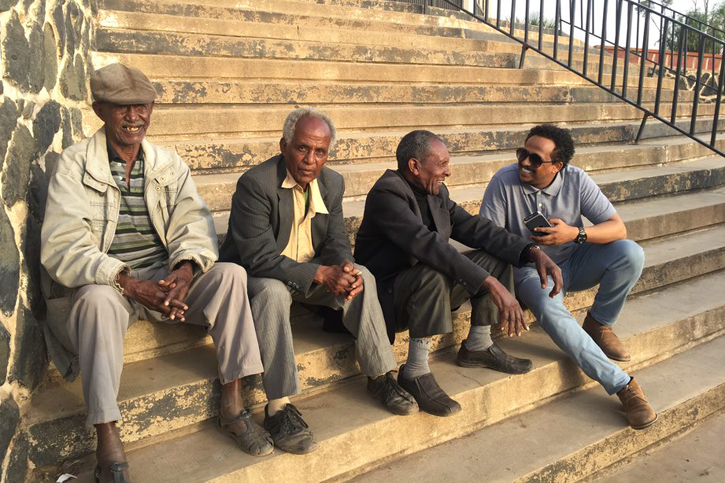 S-CAR Ph.D. student Felegebirhan Mihret making new friends with a group of local men in Asmara. Photo by Carol Pineau.