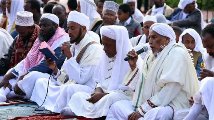 Muslims gather to perform the Eid Al-Adha prayer at Addis Ababa Stadium in Ethiopia on August 11, 2019. Muslims worldwide celebrate Eid Al-Adha, to commemorate the holy Prophet Ibrahim's (Prophet Abraham) readiness to sacrifice his son as a sign of his obedience to God, during which they sacrifice permissible animals, generally goats, sheep, and cows. Eid-al Adha is the one of two most important holidays in the Islamic calendar, with prayers and the ritual sacrifice of animals. ( Minasse Wondimu Hailu - Anadolu Agency )