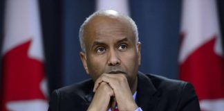 Minister of Immigration, Refugees and Citizenship Ahmed Hussen pauses in Ottawa on Tuesday, May 7, 2019. Immigration Minister Ahmed Hussen says he is concerned by numbers in a new poll that suggest a majority of Canadians believe the government should limit the number of immigrants it accepts since the country might be reaching a limit to its ability to integrate them. THE CANADIAN PRESS/Sean Kilpatrick