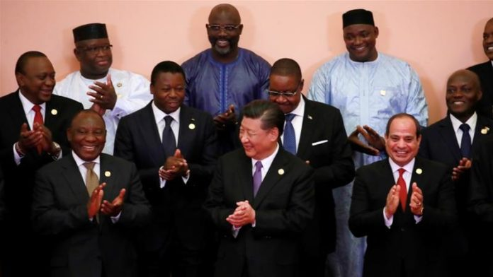 Chinese President Xi Jinping and African leaders clap during a group photo session during the FOCAC Summit in Beijing, China, September 3, 2018 [File: How Hwee Young/Reuters]