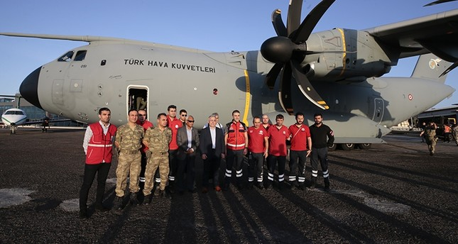 Turkish medical staff pose in front of the military aircraft ahead of their departure to Somalia on Tuesday, Jan. 21, 2020. (AA Photo)