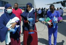 Medical personnel carry wounded children to be airlifted to the Turkish capital for treatment after they were injured in Saturday's car bomb blast in Mogadishu, Somalia, Sunday, Dec. 29, 2019./AP