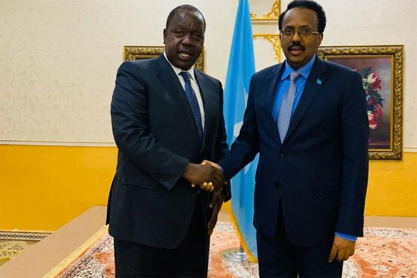 Somali President Mohamed Farmaajo (right), receives a Kenyan Interior Cabinet Secretary Fred Matiang'i in Mogadishu on March 8, 2020. PHOTO | COURTESY