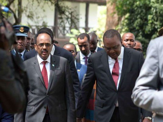 President Uhuru Kenyatta with his Somalia counterpart Mohamed Abdullahi Farmajo after the National Prayer Breakfast at Safari Park hotel in Nairobi on May 31, 2018. PHOTO | DENNIS ONSONGO | NATION MEDIA GROUP