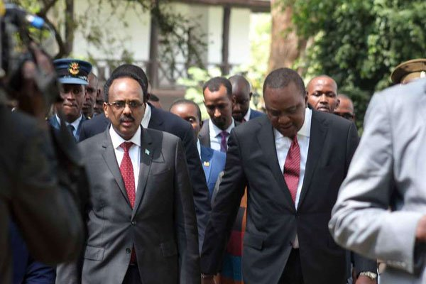 President Uhuru Kenyatta with his Somalia counterpart Mohamed Abdullahi Farmajo after the National Prayer Breakfast at Safari Park hotel in Nairobi on May 31, 2018. PHOTO | DENNIS ONSONGO | NATION MEDIA GROUP