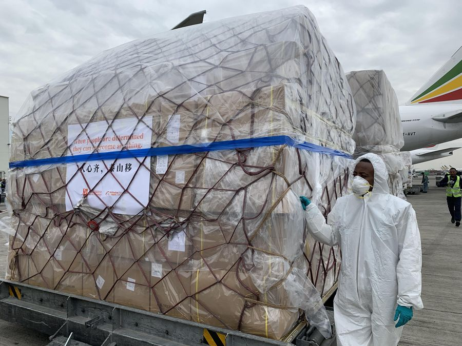 Staff members offload the medical supplies from China at the airport in Addis Ababa, Ethiopia, March 22, 2020. (Xinhua/Wang Shoubao)