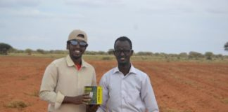 Khaalid and Saeed in the piece of land where they're working on