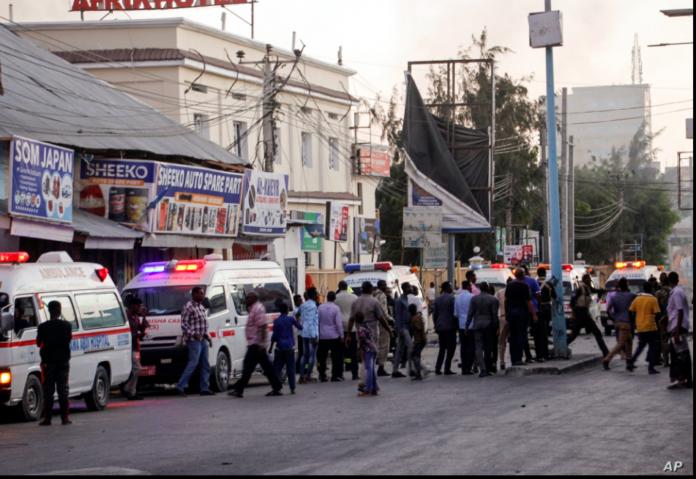 Ambulances and security forces gather on the street outside the Afrik hotel in the capital Mogadishu, Somalia, Jan. 31, 2021. CREDIT AP