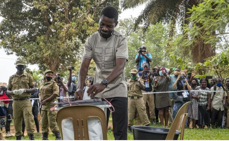 Bobi Wine is hoping to bring to an end President Museveni's 35-year reign [Jerome Delay/AP]