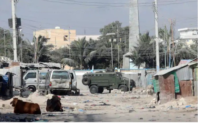 An armored personnel carrier drives on a sealed off street to prevent a protest over delayed elections in Mogadishu, Somalia, on Feb. 19. (Feisal Omar/Reuters)