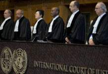 Judges enter the International Court of Justice, or World Court, in The Hague, Netherlands, Wednesday, Oct. 3, 2018, where they ruled on an Iranian request to order Washington to suspend U.S. sanctions against Tehran. (AP Photo/Peter Dejong)