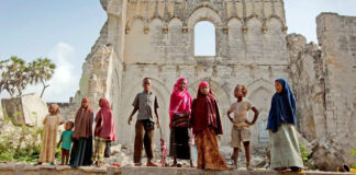 IRIN/Kate Holt Children stand before the remains of Mogadishu cathedral, built by the Italian colonial authorities in Somalia. (file)