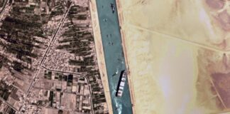 "This satellite photo from Planet Labs Inc. shows the Ever Given cargo ship stuck in Egypt's Suez Canal Monday, March 29, 2021. Engineers on Monday ""partially refloated"" the colossal container ship that continues to block traffic through the Suez Canal, authorities said, without providing further details about when the vessel would be set free. (Planet Labs Inc. via AP)"