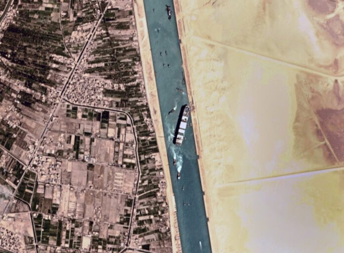 This satellite photo from Planet Labs Inc. shows the Ever Given cargo ship stuck in Egypt's Suez Canal Monday, March 29, 2021. Engineers on Monday