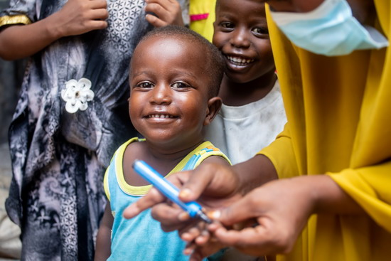 A young child is to be vaccinated as part of national polio vaccination campaign in Mogadishu, Somalia on Wednesday 28 October 2020. WHO Somalia is running the second round of their polio Campaign. Photo: Siyaad Mohamed /Ildoog/ WHO SOMALIA