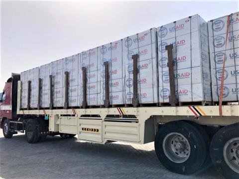 A truck loaded with heavy-duty plastic sheeting is prepared to make the trip to Tigray, Ethiopia, where an estimated 1 million people are displaced by conflict. Photo: OIM 2021