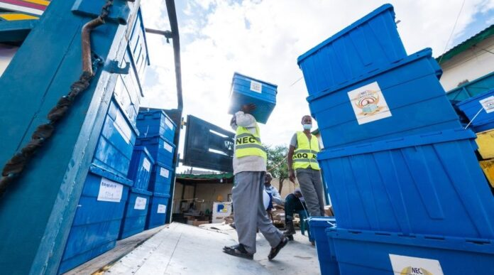 Officials of the electoral commission readying ballot boxes for distribution ahead of the election day. Photo credit: Richard Harper